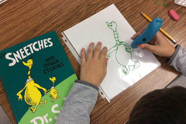 A student creates a 3D tracing of one of Dr. Seuss' iconic characters using the 3Doodler Start 3D printing pen.