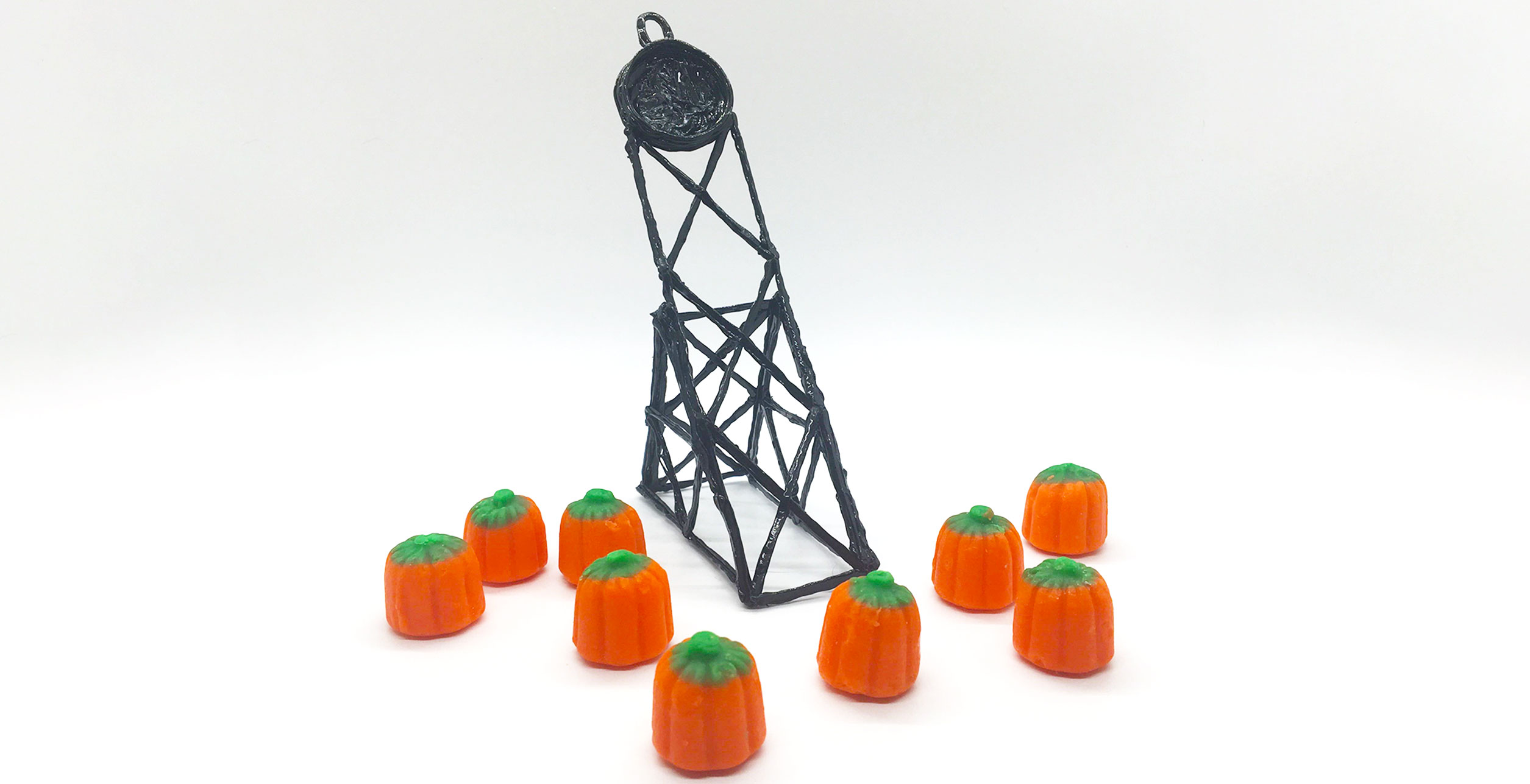 The main image depicts a small catapult made with the 3Doodler pen, and some mini mellowcreme pumpkins for launching with the catapult.